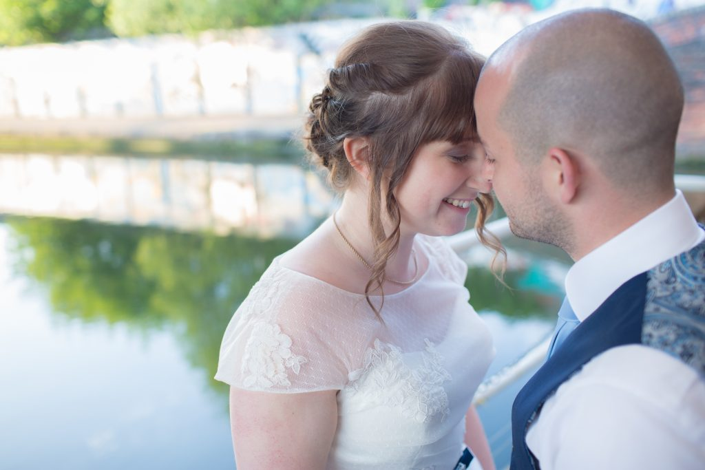 bride and groom at the bond company by canal