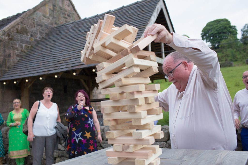 wedding guest playing jenga at the ashes barns wedding venue