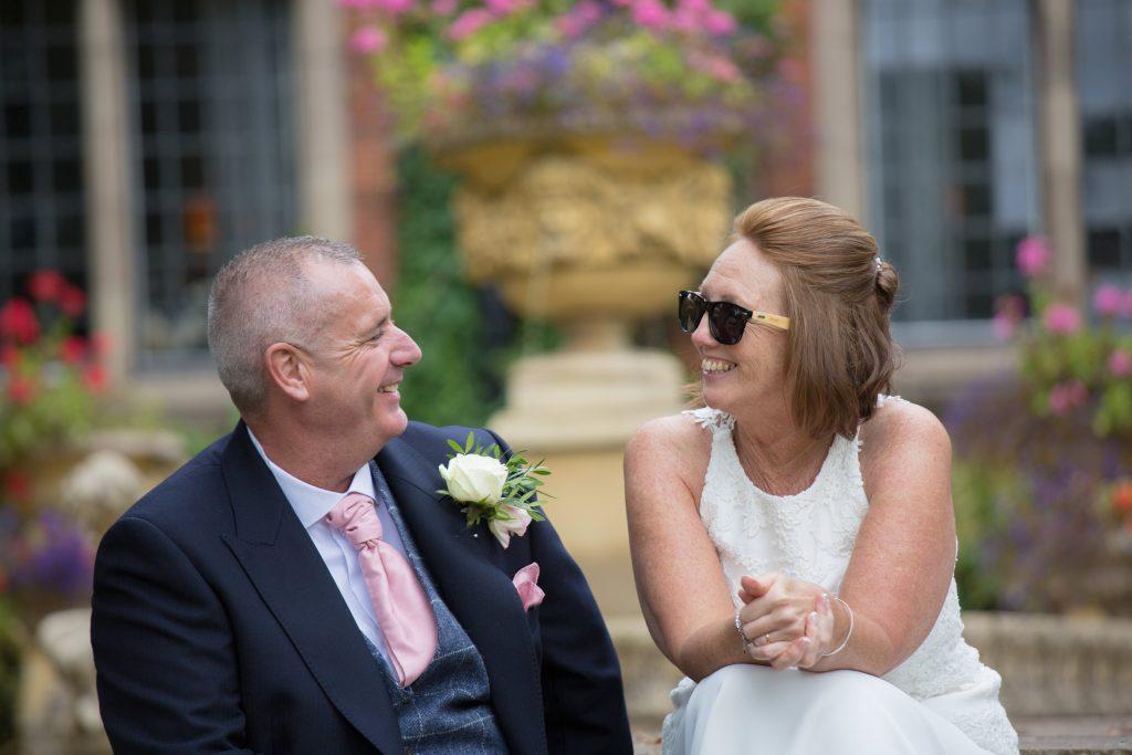bride wearing grooms sunglasses