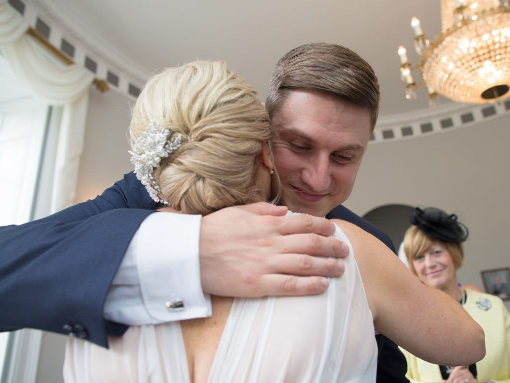 son of bride hugging her