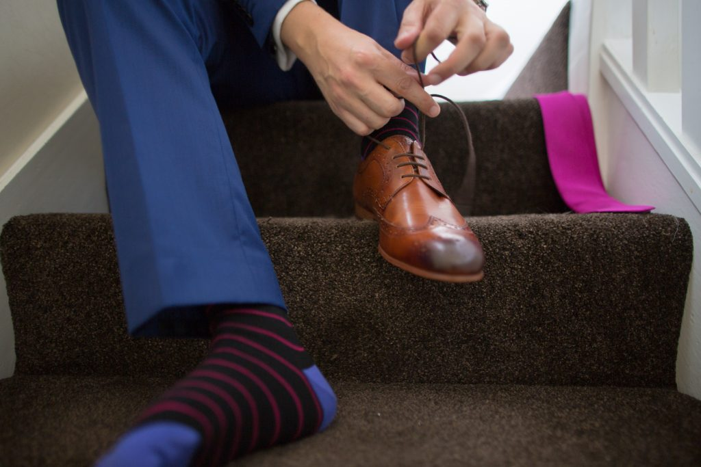 groom tying shoes