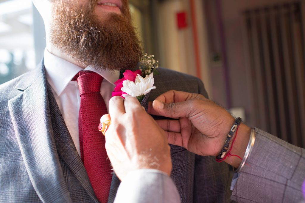 Groom having button hole attached to suit