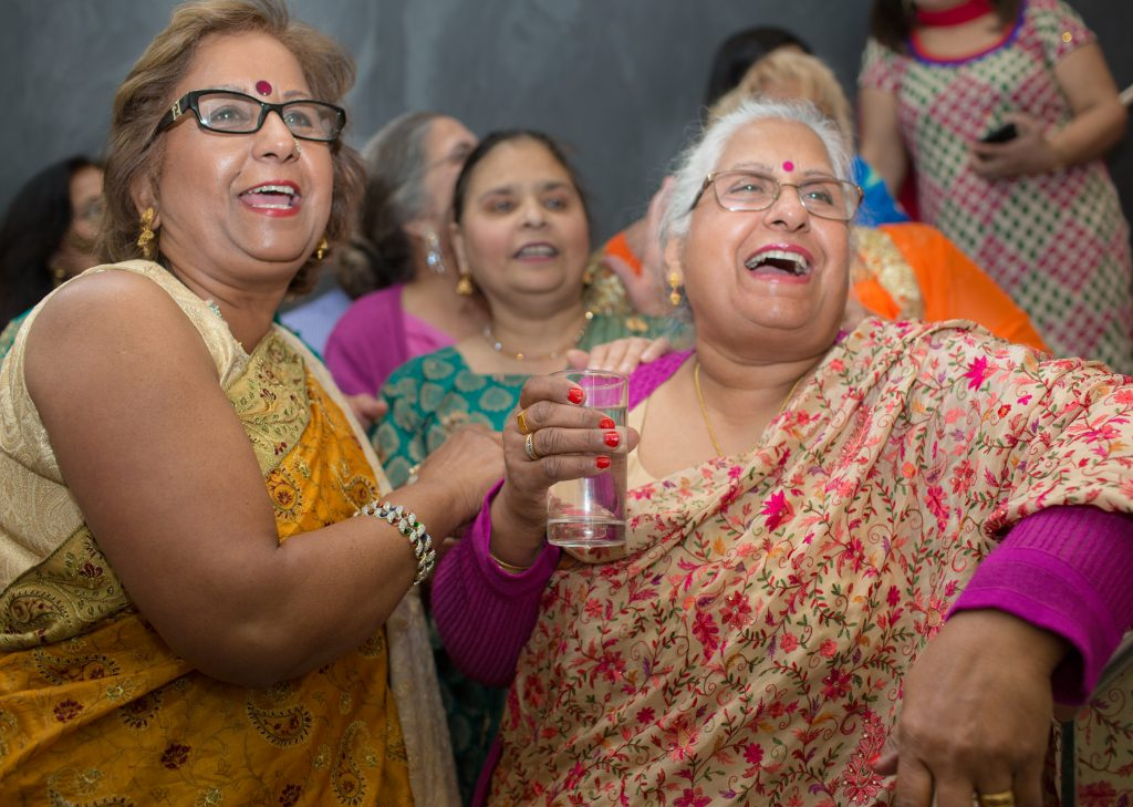 banter between women at wedding party