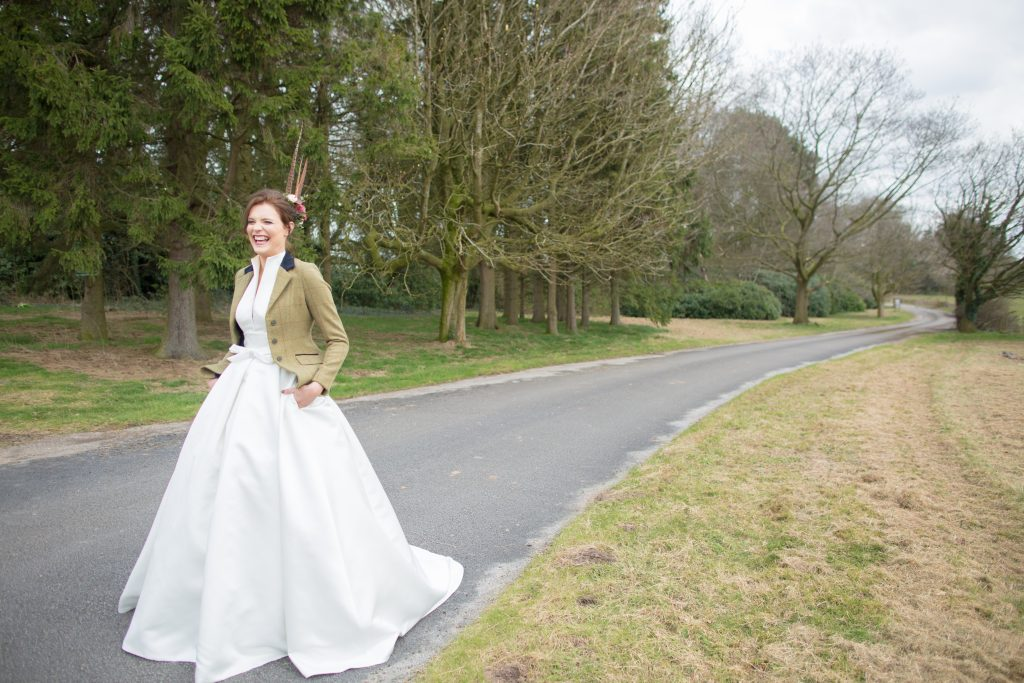 Photo of bride smiling on drive of Standon Hall