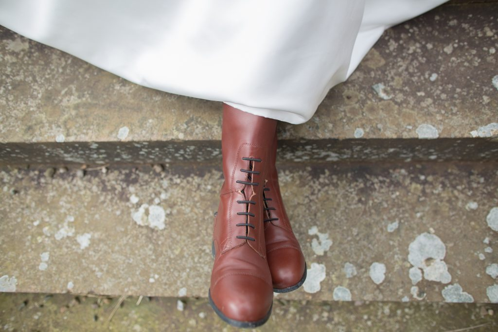 Close up photo of brides boots