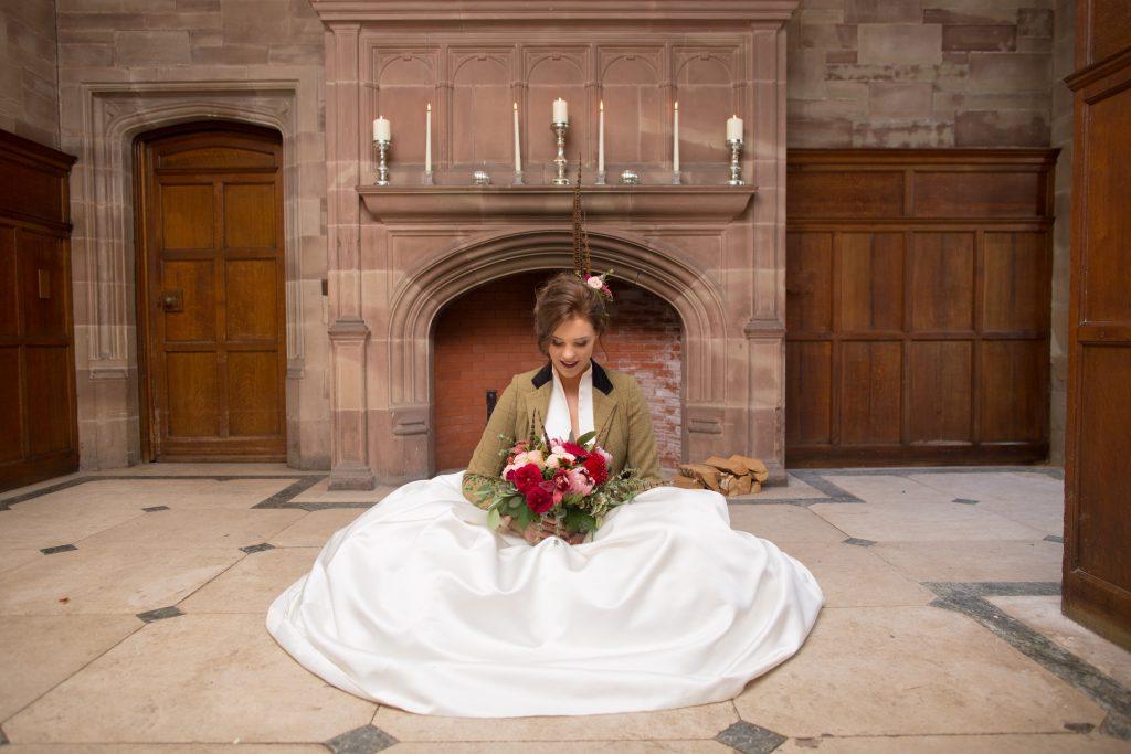 Bride sat on floor inside Standon Hall