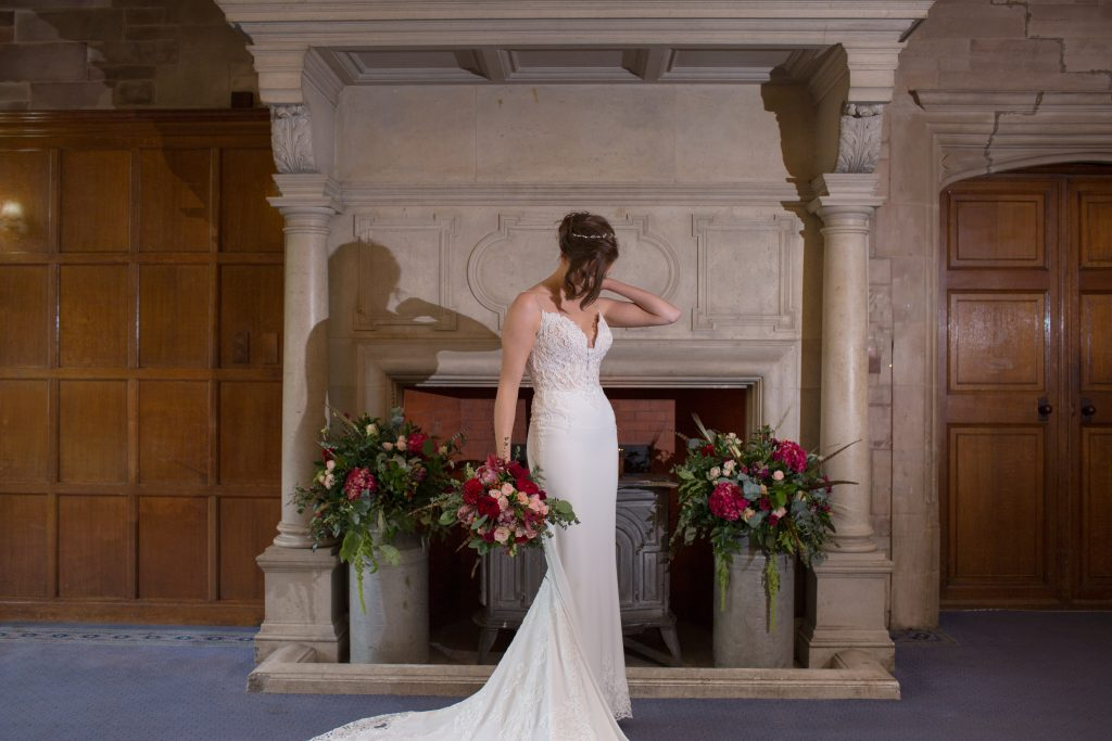 Bride stood in front of fireplace at Standon Hall