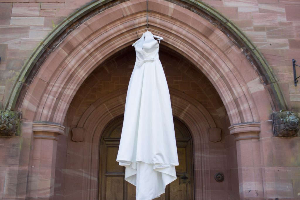 Wedding dress hanging in archway
