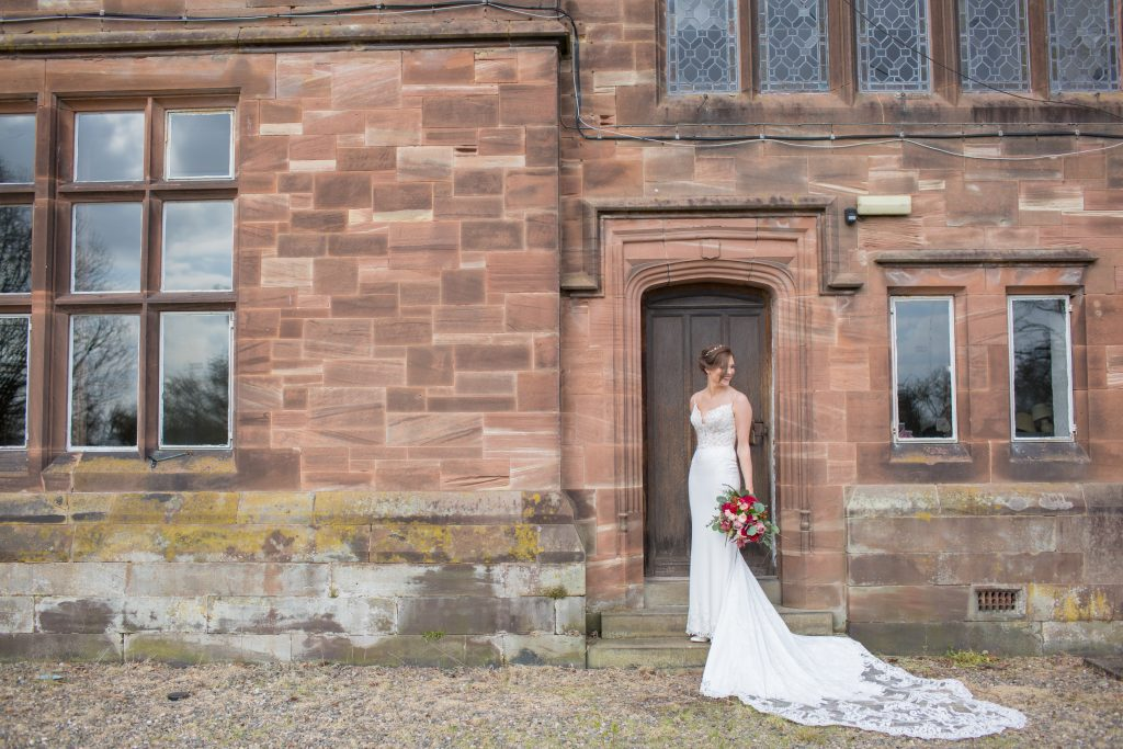Photo of bride taken stood by door at Standon Hall