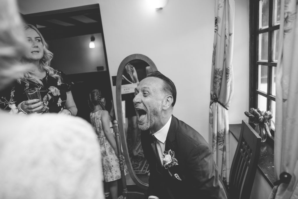 wedding guest at the Mytton and Mermaid laughing