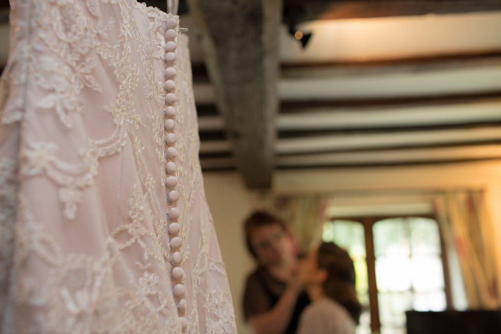 Blush wedding dress hanging up
