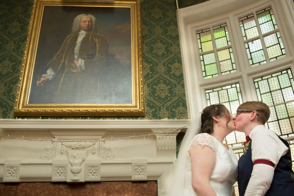 two brides kissing after getting married