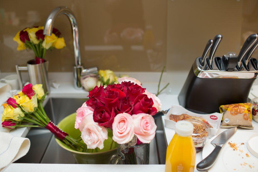 wedding flowers in kitchen sink