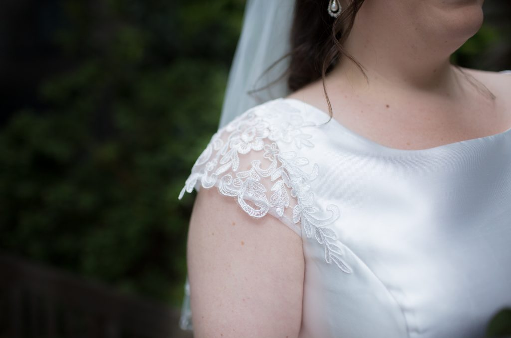 close up detail photo of wedding dress sleeve