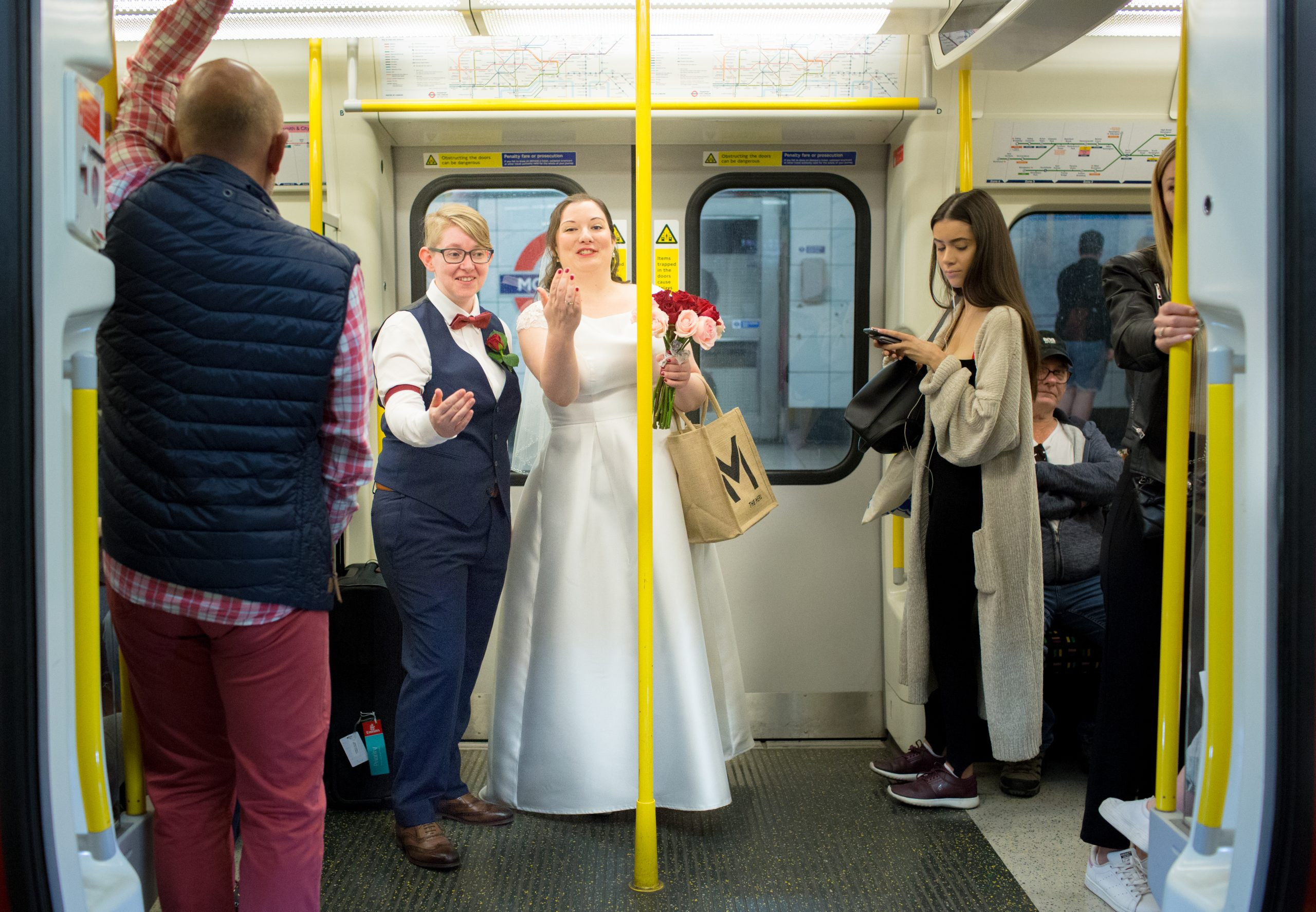 two brides on a tube train in London