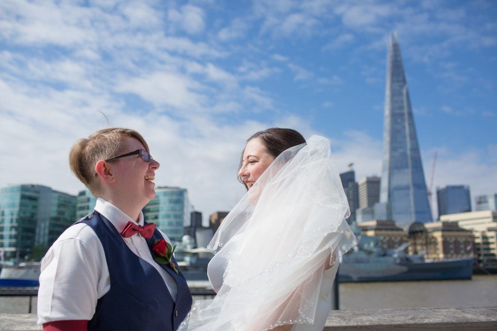 two brides next to the river thames with the shard in the background