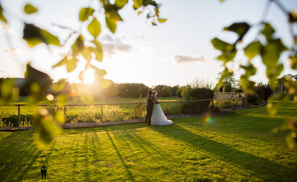bride and groom practicing first dance at sunset