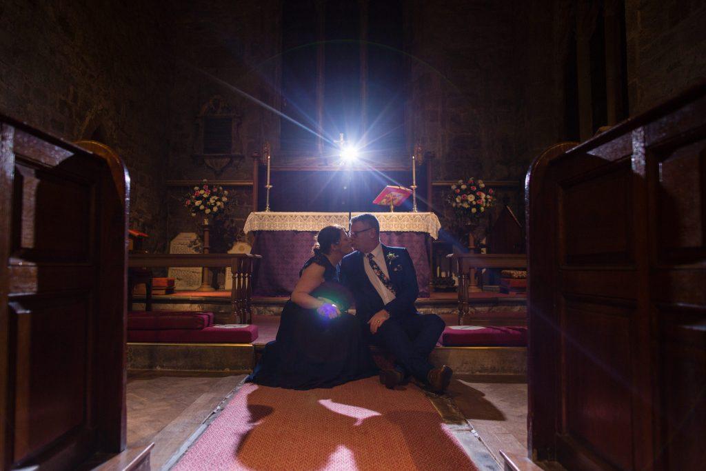 newly married couple kiss inside church