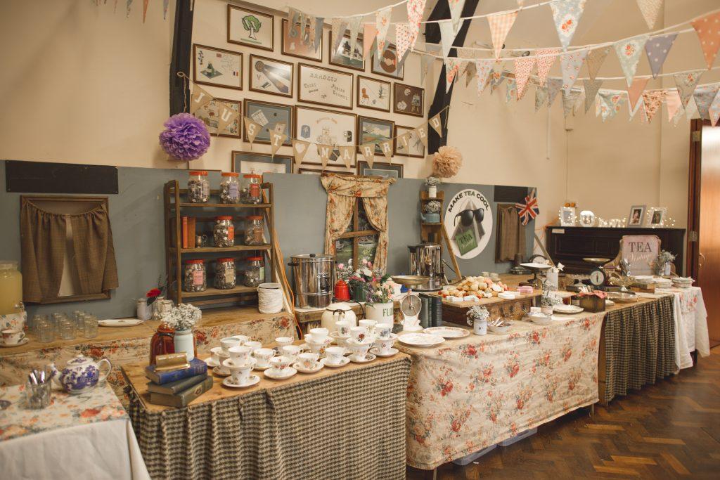 vintage tea room set up at wedding in village hall
