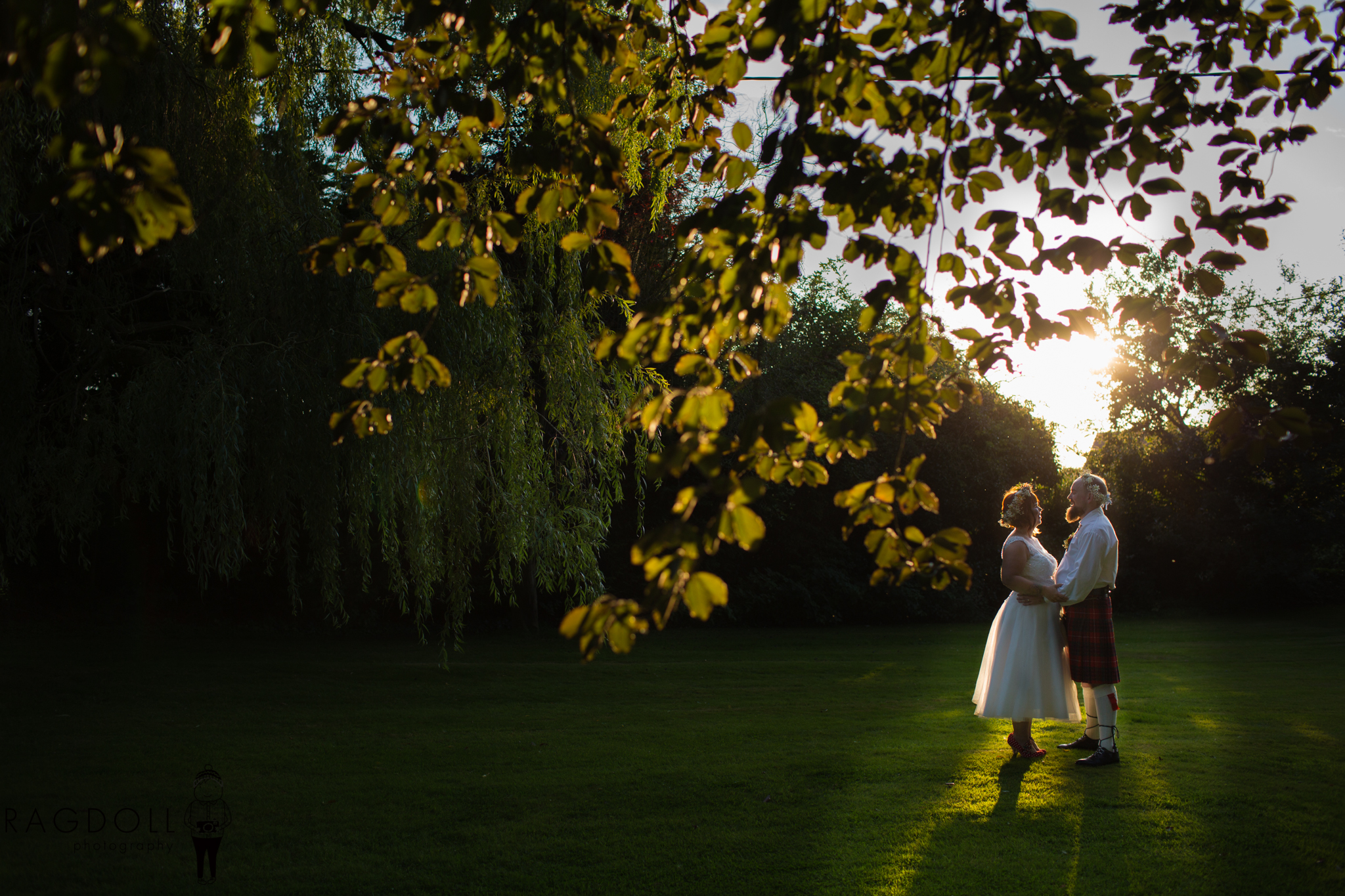 photo of newly married couple in golden light