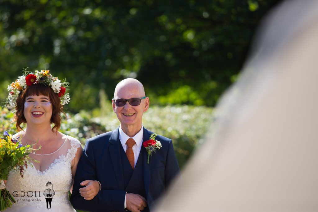 father of bride walking daughter into ceremony