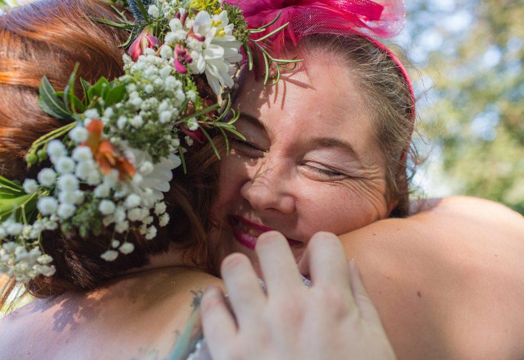 wedding guest hugging bride