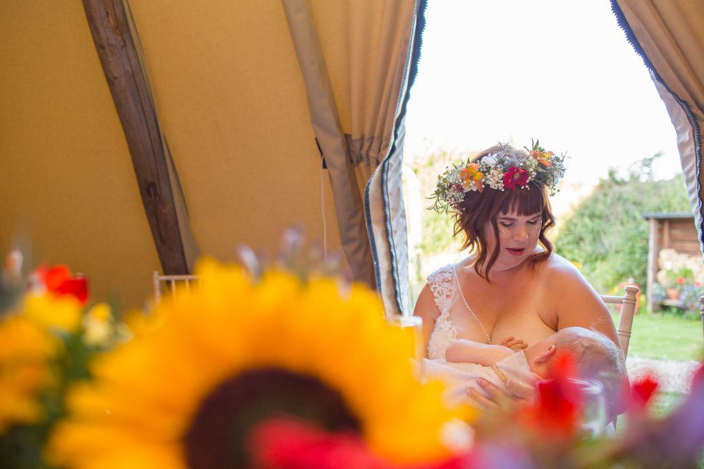 bride breastfeeding baby at the wroxeter hotel
