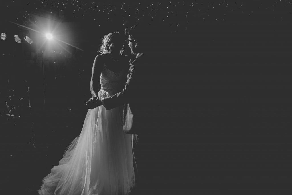 black and white photo of couple doing first dance