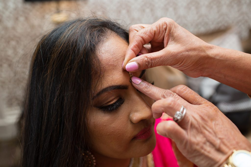 guest having bindi applied