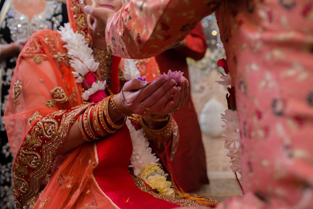 close up picture of hands during hindu ceremony