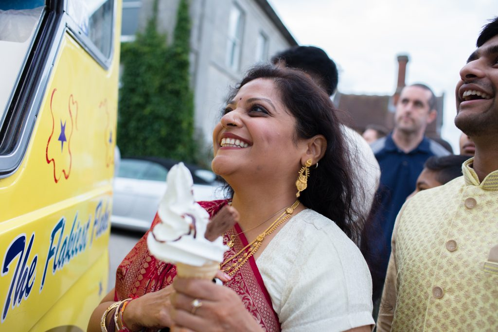 wedding guest holding icecream
