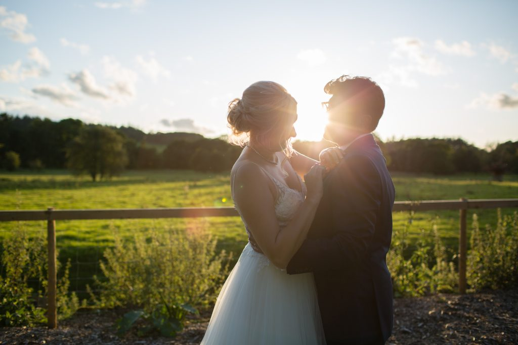 newly weds at golden hour