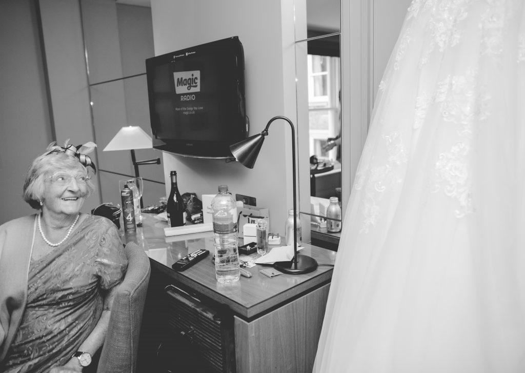grandma looking at wedding dress