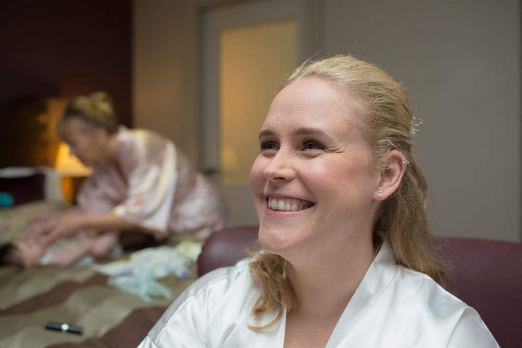photo of smiling bride during prep
