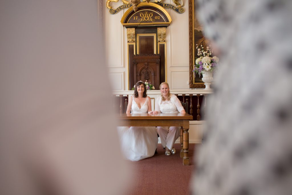 photo of two brides inside windsor guildhall