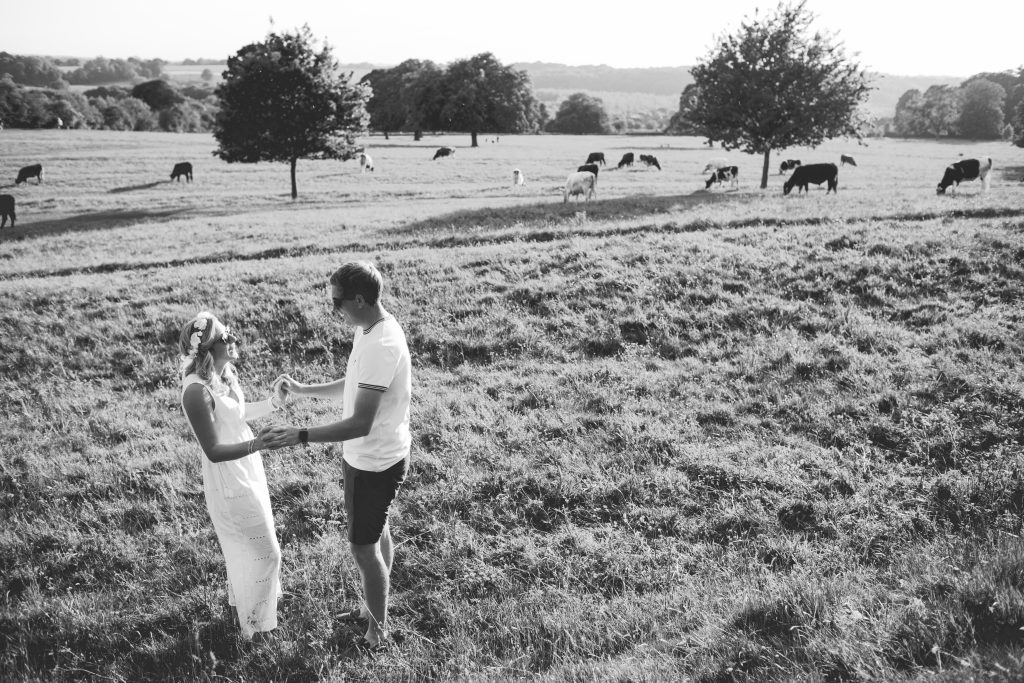 black and white photo of couple in feild