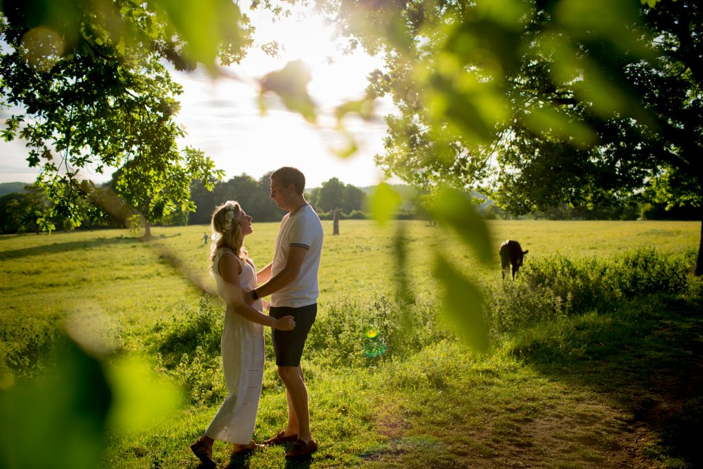 photo of bride and groom to be taken through trees